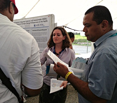 Dr. Kati Corlew distributes surveys and fact sheets about the network analysis project to participants of the 2013 Pacific Islands Climate Services Forum in Suva, Fiji.