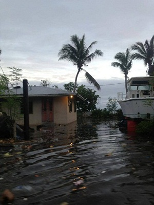 Inundation from the high tide event and storm surge flooded neighborhoods of southern Majuro, causing extensive damage to people's homes and crops. Photo by Anole Valdez, 2013. All rights reserved.