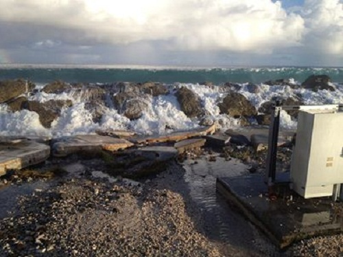 Waves crashing over a seawall in Majuro during the June 25, 2013 flooding. Photo by Murray Ford, 2013. All rights reserved.
