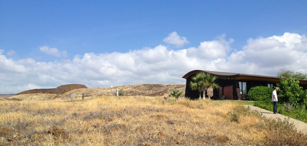 Figure 1: Pu'ukohala Visitor Center (foreground) and heiau, Kawaihae Bay, Hawai'i. Photo by Laura Brewington.